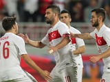 Turkey's captain Arda Turan (C) is congratulated by teammates after his goal during their friendly football match against Qatar in the capital Doha on November 13, 2015.
