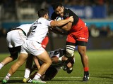 Billy Vunipola of Saracens is stopped by Julien Marchand during the European Rugby Champions Cup match between Saracens and Toulouse at Allianz Park on November 14, 2015 in Barnet, England.