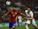 Spain's forward Diego Costa (L) vies with England's defender Phil Jones during the friendly football match Spain vs England at the Jose Rico Perez stadium in Alicante on November 13, 2015.
