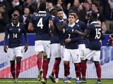 French midfielder Blaise Matuidi, French defender Raphael Varane, French midfielder Paul Pogba, French forward Olivier Giroud, French midfielder Antoine Griezmann and French defender Bacary Sagna celebrate after Giroud opened the scoring during a friendly