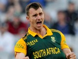 Ryan McLaren of South Africa (R) celebrates after taking the wicket of Australia's Shane Watson during the fourth one-day international cricket match between Australia and South Africa at the MCG in Melbourne on November 21, 2014.