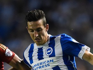 Lewis Dunk of Brighton is challenged by Eric Lichaj of Nottingham Forest during the Sky Bet Championship match between Brighton & Hove Albion and Nottingham Forest at Amex Stadium on August 7, 2015