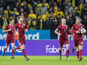 Denmark 19 Nicolai Jorgensen celebrates scoring during a European Qualifier Play-Off between Sweden and Denmark on November 14, 2015 in Solna, Sweden.