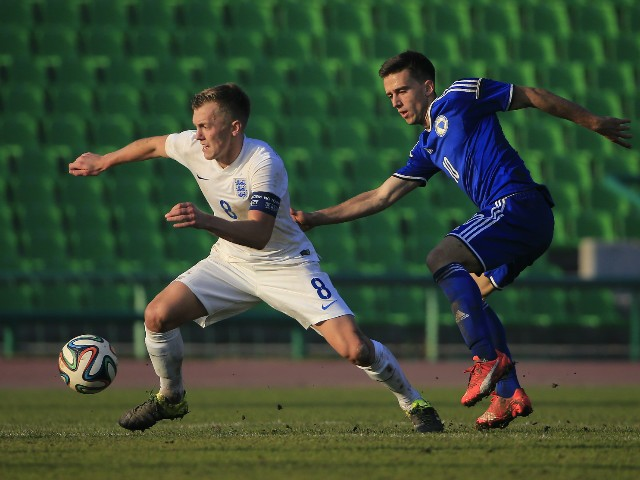 James Ward-Prowse (L) of England in action against Armin Cerimagic (R) of Bosnia during the European Under 21 Qualifier match between Bosnia and Herzegovina U-21 and England U-21at Stadium Asim Ferhatovic Hase on November 12, 2015 in Sarajevo, Bosnia and