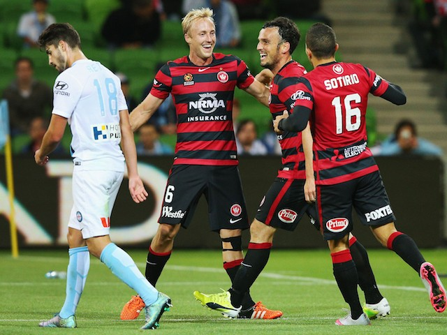 Mitch Nichols (L) of the Wanderers celebrates a goal by Mark Bridge of the Wanderers (C) during the round six A-League match between Melbourne City FC and the Western Sydney Wanderers at AAMI Park on November 13, 2015 in Melbourne, Australia.
