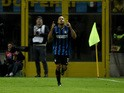 Inter Milan's forward from France Jonathan Biabiany celebrates after scoring during the Italian Serie A football match Inter Milan vs Frosinone on November 22, 2015