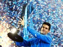 Novak Djokovic of Serbia lifts the trophy following his victory during the men's singles final against Roger Federer of Switzerland on day eight of the Barclays ATP World Tour Finals at the O2 Arena on November 22, 2015