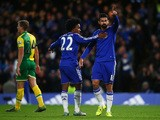 Diego Costa (R) of Chelsea celebrates scoring his team's first goal with his team mate Willian (L) during the Barclays Premier League match between Chelsea and Norwich City at Stamford Bridge on November 21, 2015
