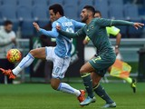 Lazio's midfielder from Brazil Felipe Anderson (L) vies with Palermo's defender from Morocco Achraf Lazaar during the Italian Serie A football match between SS Lazio and Palermo on November 22, 2015 at the Olympic stadium in Rome.
