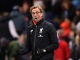 Jurgen Klopp, manager of Liverpool celebrates his team's fourth goal during the Barclays Premier League match between Manchester City and Liverpool at Etihad Stadium on November 21, 2015 in Manchester, England.