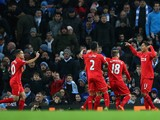 Roberto Firmino (1st R) of Liverpool celebrates scoring his team's third goal with his team mates during the Barclays Premier League match between Manchester City and Liverpool at Etihad Stadium on November 21, 2015 in Manchester, England.
