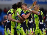Sam James of Sale Sharks is congratulated after scoring a try by his team mates during the European Rugby Challenge Cup match between Sale Sharks and Pau at AJ Bell Stadium on November 21, 2015