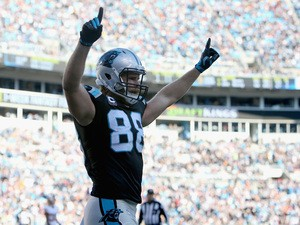 Greg Olsen #88 of the Carolina Panthers celebrates a 3rd quarter Panthers touchdown against the Washington Redskins during their game at Bank of America Stadium on November 22, 2015