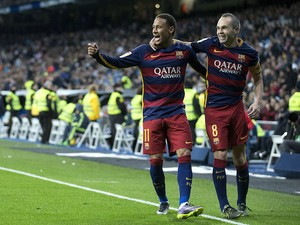 Neymar JR. (L) of FC Barcelona celebrates scoring their second goal with teammate Andres Iniesta (R) during the La Liga match between Real Madrid CF and FC Barcelona at Estadio Santiago Bernabeu on November 21, 2015 in Madrid, Spain.