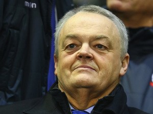 Phil Gartside the chairman of Bolton looks on from the main stand during the FA Cup fourth round match between Liverpool and Bolton Wanderers at Anfield on January 24, 2015