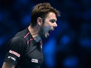 Switzerland's Stan Wawrinka celebrates winning the first set against Britain's Andy Murray during a men's singles group stage match on day six of the ATP World Tour Finals tennis tournament in London on November 20, 2015.