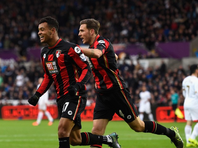 Bournemouth player Joshua King (l) and Dan Gosling celebrate the opening goal during the Barclays Premier League match between Swansea City and A.F.C. Bournemouth at Liberty Stadium on November 21, 2015