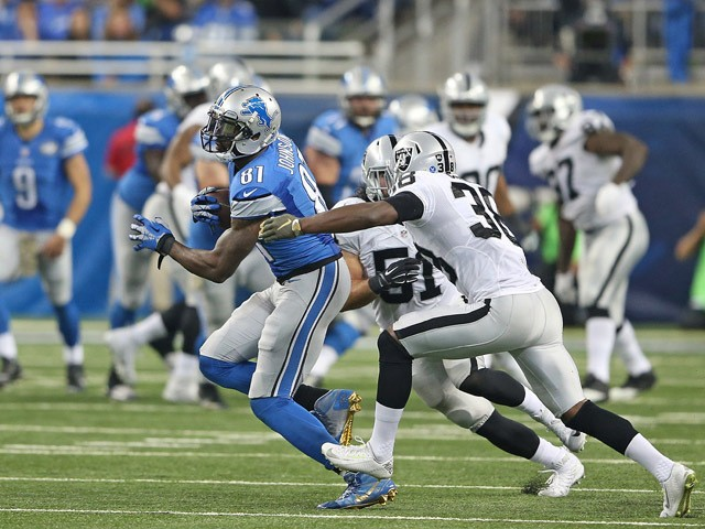 Calvin Johnson #81 of the Detroit Lions make a first down catch during the second quarter of the game against the Oakland Raiders on November 22, 2015