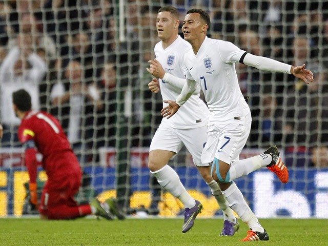 England's midfielder Dele Alli (R) celebrates scoring his team's first goal during the friendly football match between England and France at Wembley Stadium in west London on November 17, 2015