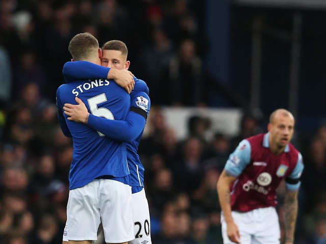 Ross Barkley (C) of Everton celebrates scoring his team's first goal with his team mate John Stones (L) during the Barclays Premier League match between Everton and Aston Villa at Goodison Park on November 21, 2015