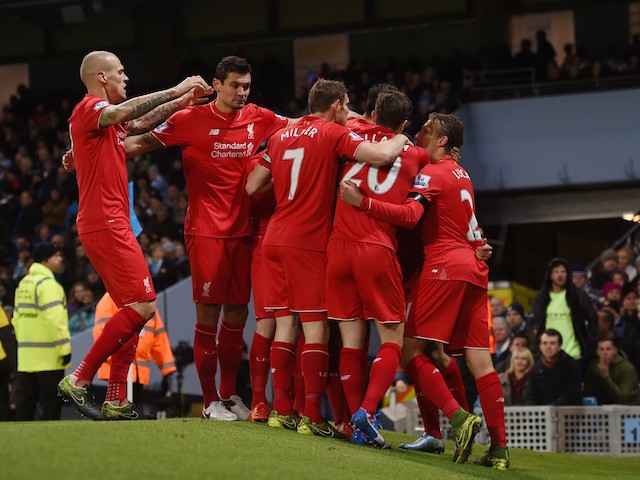 Liverpool players celebrate their team's first goal scored by Eliaquim Mangala of Manchester City during the Barclays Premier League match between Manchester City and Liverpool at Etihad Stadium on November 21, 2015 in Manchester, England.