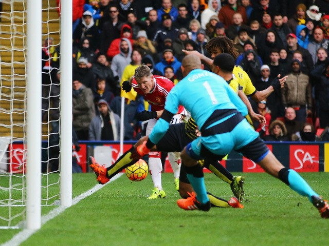 Bastian Schweinsteiger (L) of Manchester United centres the ball resulting in the own goal by Troy Deeney of Watford during the Barclays Premier League match between Watford and Manchester United at Vicarage Road on November 21, 2015