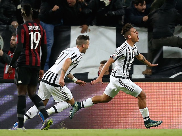Juventus' forward Argentinian Paulo Dybala (R) celebrates with teammates after scoring a goal during the Italian Serie A football match between Juventus and AC Milan on November 21, 2015 at the Juventus Stadium in Turin.