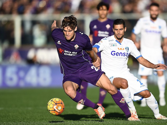 Empoli's defender from France Vincent Laurini vies with Fiorentina's defender from Spain Marcos Alonso Mendoza (L) during the Italian Serie A football match Fiorentina vs Empoli at the Artemio Franchi Stadium on November 22, 2015 in Florence.