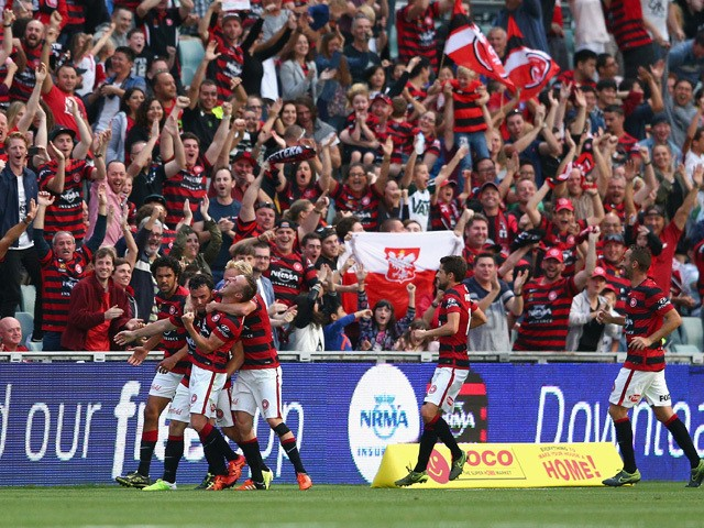 Mark Bridge of the Wanderers celebrates scoring a goal with team mates during the round seven A-League match between Western Sydney Wanderers and Wellington Phoenix at Pirtek Stadium on November 21, 2015