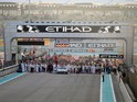 F1 personnel, teams and media mill around on the starting grid before the start of the Abu Dhabi Formula One Grand Prix at the Yas Marina circuit on November 29, 2015.