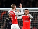 Mesut Ozil of Arsenal (r) celebrates scoring his side's first goal with Per Mertesacker of Arsenal during the UEFA Champions League match between Arsenal FC and GNK Dinamo Zagreb at Emirates Stadium on November 24, 2015