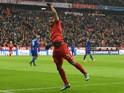 Bayern Munich's Brazilian midfielder Douglas Costa celebrates after his goal during the UEFA Champions League Group F football match between FCB Bayern Munich and Olympiakos Piraeus on November 24, 2015