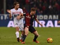 Cristian Daniel Ansaldi (R) of Genoa CFC is challenged by Lorenzo Lollo of Carpi FC during the Serie A match between Genoa CFC and Carpi FC at Stadio Luigi Ferraris on November 29, 2015 in Genoa, Italy.
