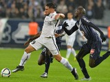 Caen's French forward Andy Delort (L) vies with Bordeaux's French defender Cedric Yambere during the French L1 football match between Bordeaux and Caen on November 29, 2015 at the Matmut Atlantique stadium in Bordeaux, southwestern France.