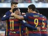 Barcelona's Brazilian forward Neymar (C) celebrates with Barcelona's defender Gerard Pique (L) and Barcelona's Uruguayan forward Luis Suarez after scoring during the Spanish league football match FC Barcelona vs Real Sociedad de Futbol at the Camp Nou sta