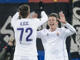 Fiorentina's Italian forward Federico Bernardeschi (R) celebrates with Slovenian midfielder Josip Ilicic after scoring a goal during the UEFA Europa League group I football match between Basel and Fiorentina at the St Jakob stadium in Basel on November 26