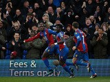 Crystal Palace's French-born Congolese midfielder Yannick Bolasie (L), celebrates with Crystal Palace's Senegalese defender Pape Souare (C) and Crystal Palace's French midfielder Yohan Cabaye after scoring his team's second goal during the English Premier