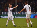 Gaetano Letizia (L) and Simone Romagnoli of Carpi FC celebrate victory at the end of the Serie A match between Genoa CFC and Carpi FC at Stadio Luigi Ferraris on November 29, 2015 in Genoa, Italy.