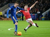 Leicester City's English striker Jamie Vardy (L) shoots and scores past Manchester United's Italian defender Matteo Darmian during the English Premier League football match between Leicester City and Manchester United at the King Power Stadium in Leiceste