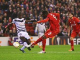 Christian Benteke of Liverpool shoots past Henri Saivet of Bordeaux as he