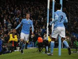 Manchester City's Belgian midfielder Kevin De Bruyne (L) celebrates after scoring during the English Premier League football match between Manchester City and Southampton at The Etihad stadium in Manchester, north west England on November 28, 2015