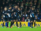 Mesut Ozil of Arsenal (2L) celebrates with team mates as he scores their first goal during the Barclays Premier League match between Norwich City and Arsenal at Carrow Road on November 29, 2015 in Norwich, England.
