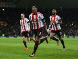 Patrick van Aanholt of Sunderland celebrates scoring his team's first goal during the Barclays Premier League match between Sunderland and Stoke City at Stadium of Light on
