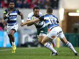 Telusa Veainu of Leicester is tackled by George Ford during the Aviva Premiership match between Leicester Tigers and Bath at Welford Road on November 29, 2015 in Leicester, England.
