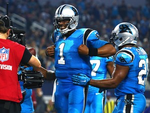 Cam Newton #1 of the Carolina Panthers celebrates with teammate Jonathan Stewart #28 after Newton scored a touchdown against the Dallas Cowboys in the second half at AT&T Stadium on November 26, 2015 in Arlington, Texas.