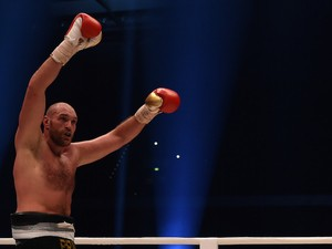 British Tyson Fury celebrates after the WBA, IBF, WBO and IBO title bout against Ukrainian world heavyweight boxing champion Wladimir Klitschko in Duesseldorf, western Germany, on November 28, 2015. Fury won the fight after 12 Rounds of Boxing.