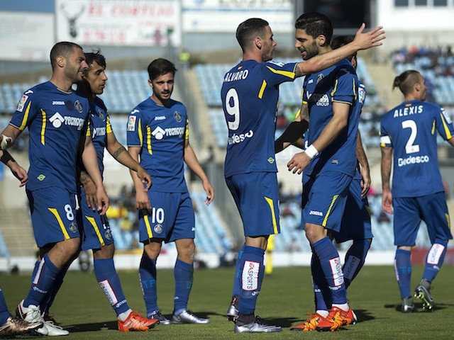 Alvaro Vazquez (3dR) of Getafe CF celebrates scoring their second goal with teammate Angel Lafita (2ndR) during the La Liga match between Getafe CF and Villareal CF at Coliseum Alfonso Perez on November 29, 2015 in Getafe, Spain.
