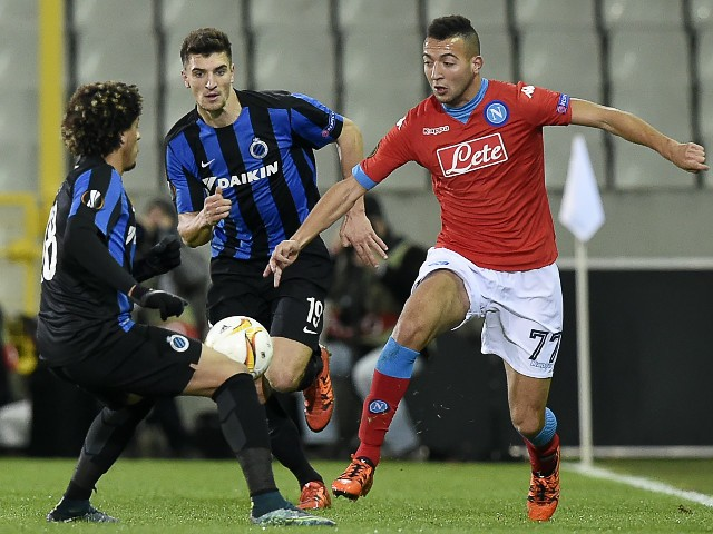 Club Bruggess Felipe Gedoz (L) vies with Napoli's Omar El Kaddouri (R) during the UEFA Europa League Group D football match between Club Brugge and SSC Napoli played behind closed doors at the Jan Breydel stadium in Bruges on November 26