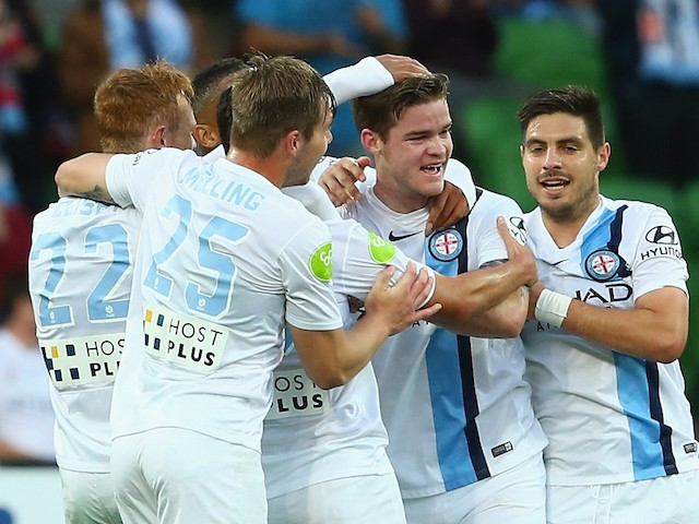 Connor Chapman of Melbourne City celebrates with team mates after scoring a goal during the round eight A-League match between Melbourne City FC and Perth Glory at AAMI Park on November 27, 2015 in Melbourne, Australia.