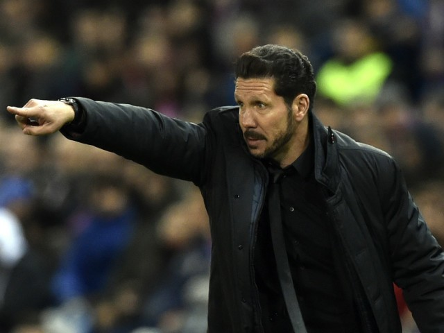 Atletico Madrid's Argentinian coach Diego Simeone gestures during the Spanish league football match Club Atletico de Madrid vs RCD Espanyol at the Vicente Calderon stadium in Madrid on November 28, 2015.